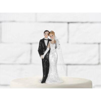 Kézfogós esküvői nászpár